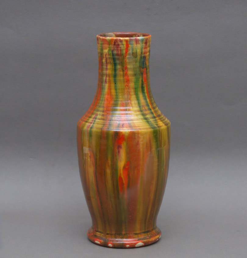 An English mulicoloured earthenware vase by C.H. Brannam, Barum